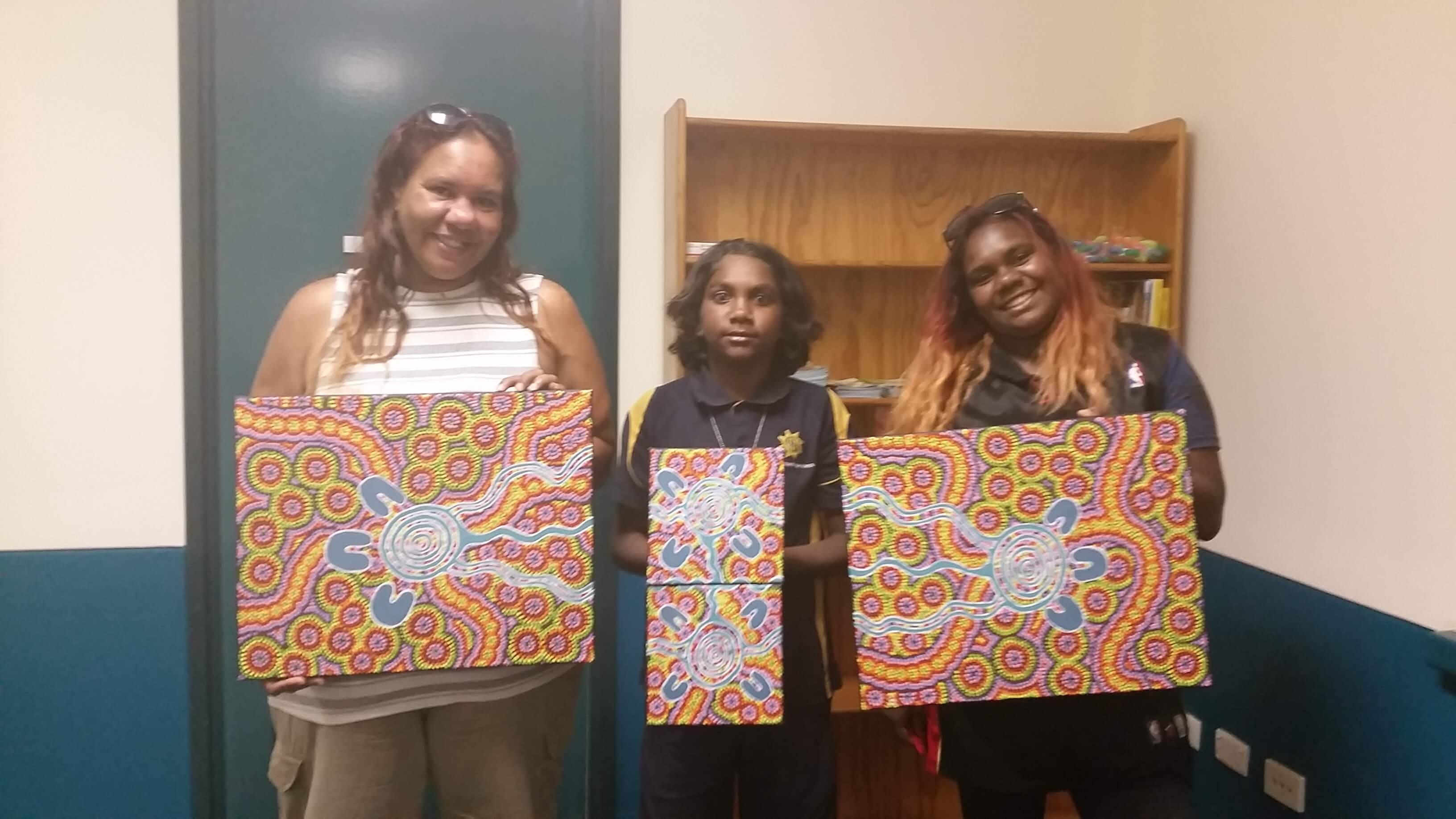 South Hedland-based artists Annabella Flatt and her child creating artwork for HelpingMinds<sup>®</sup>