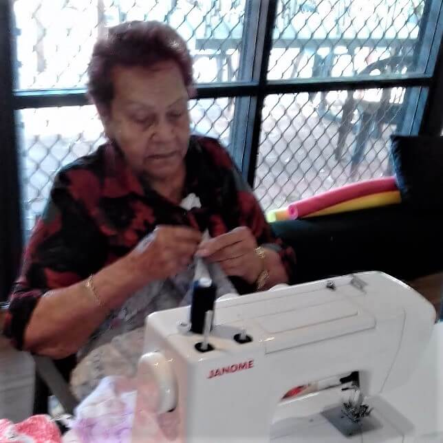 Mareen Jackamarra patchworking at South Hedland event by HelpingMinds<sup>®</sup>
